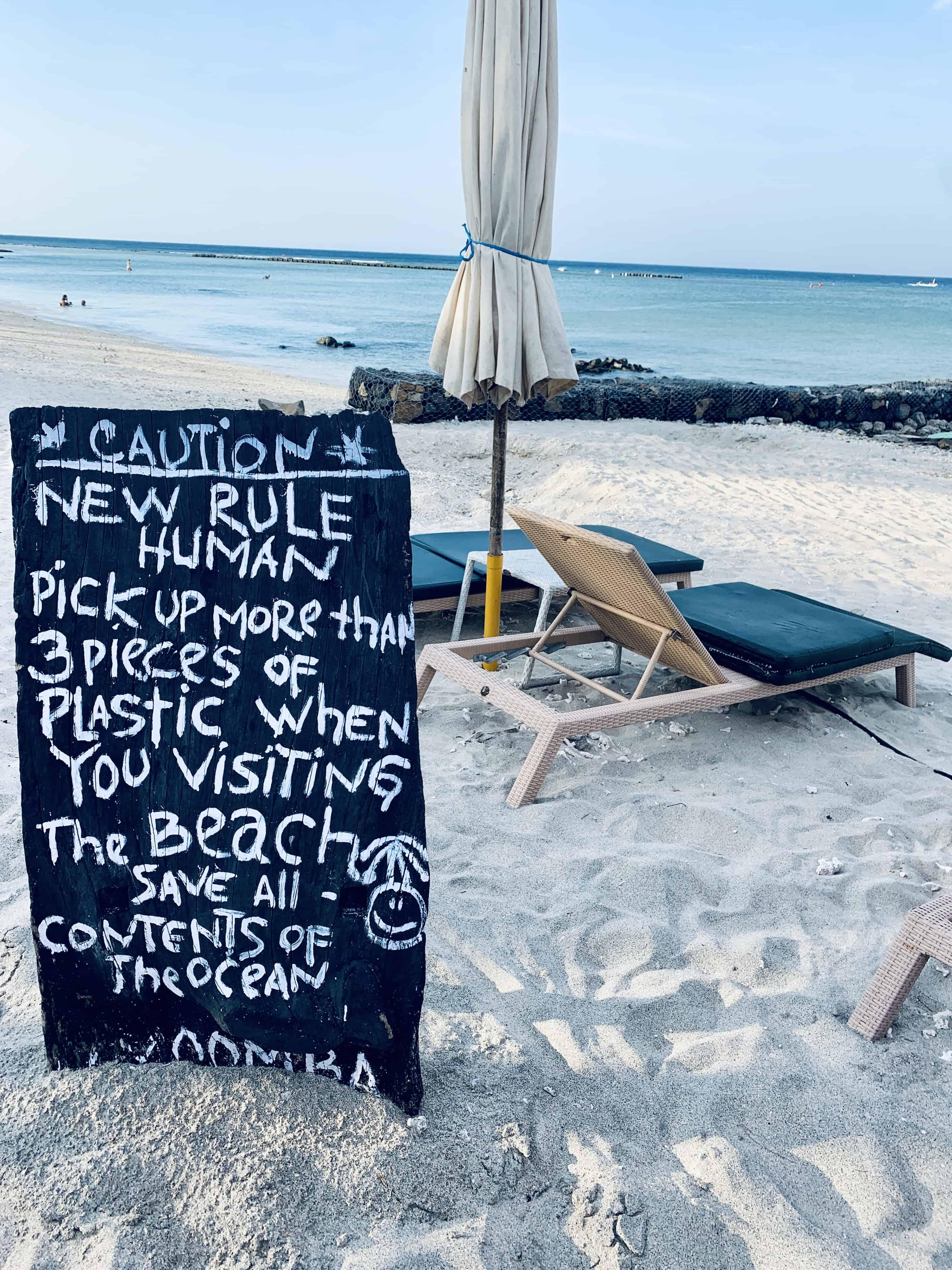 beach sign pick up trash plastic sustainability